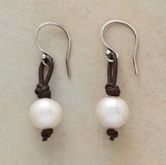 "The classic pearl earring goes modern with knotted leather loops that play off the luster with casual cool. Sterling silver French wire. Handmade in USA for Sundance. 1-1/4""L."