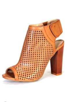 Cut out details are this season's hottest trend! Mix it up with these peep toe booties. Back strap closure.