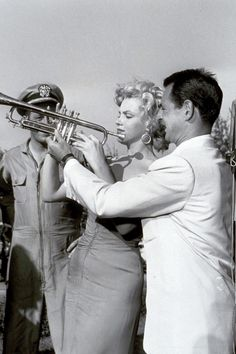 Marilyn Monroe~learning to play the trumpet