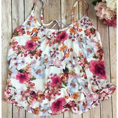 "Floral Crop Tank Top Gorgeous floral cropped tank top perfect for spring or summer! Spaghetti straps with cross-cross straps in back. 95% rayon, 5% polyester. Size L. Length is 20"". Tops Crop Tops"