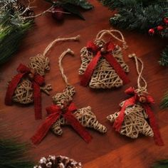 Burlap bows and jingle bells adorn these Natural Jute Wrapped Ornaments. #kirklands #holidaydecor #KirklandsHoliday