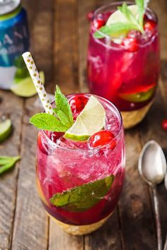 This Cranberry Mojito Punch is a festive, sparkling, and fruity large-batch cocktail that's sure to have everyone dancing the night away at your holiday party!
