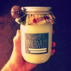 Homemade soy candle with DIY Christmas labels