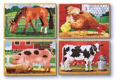 Fyra tolvbitars träpussel i box med bondgårdsmotiv.