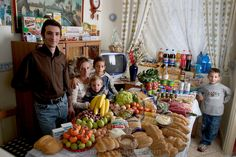 In the kitchen of their apartment in Palermo, Sicily, Italy, the Manzo family: Giuseppe, 31, Piera Marretta, 30, and their sons (left to right) Mauritio, 2, Pietro, 9, and Domenico, 7 stand and sit around a week's worth of food. Cooking methods: gas stove, microwave. Food preservation: refrigerator-freezer. Favorite foods? Giuseppe (who is a fishmonger): fish. Piera and Domenico: pasta with ragú (meat sauce). Pietro: hot dogs. Mauritio: frozen fish sticks. /// The ...