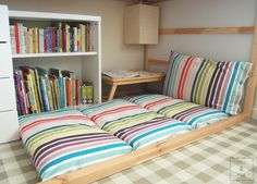 Great tutorial... floor cushions.. I think these would be great to make so that when the grandkids come to visit , we've got beds.. not just for reading..  and then roll them up and put them away ...  need to make at least 4 of these.