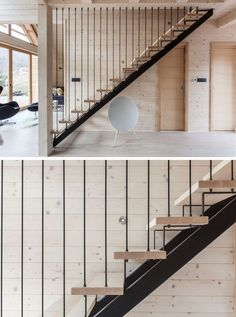 Black steel and light wood stairs lead to the upper floor of this modern house.: