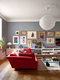 Love the paint color, plaster detail, couch, long low entertainment center.... I would do a better light fixture though!