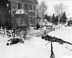 Dead German soldiers lie in the snow after an engagement with US troops in Dendenburg, Belgium, during the Battle of the Bulge, 21 January 1945. The Germans' MG-42 can be seen in the foreground.