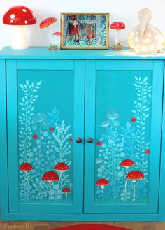 little corner of red & white mushrooms with a hand-painted cabinet.