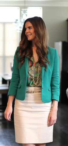teal blazer and neutral skirt