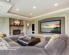 Basement idea. Like the different color behind TV.