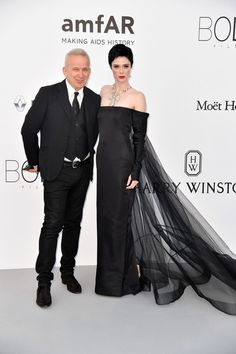 French fashion designer Jean-Paul Gaultier (L) and Canadian model Coco Rocha pose as they arrive for the amfAR's 24th Cinema Against AIDS Gala on May 25, 2017 at the Hotel du Cap-Eden-Roc in Cap d'Antibes, France. / AFP PHOTO / ALBERTO PIZZOLI