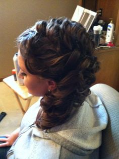 curls, and weaved to the side
