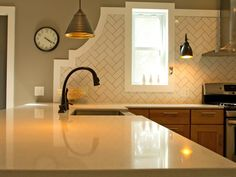 Ceramic Tile - 30 Splashy Kitchen Backsplashes on HGTV . Inexpensive subway tile laid in design gives great look.