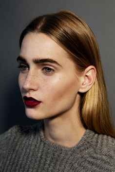 strong brows, wine lips