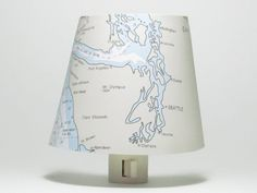 Puget Sound opens to the glorious archipelago that is Seattle Washington. Tacoma, Port Angeles, Everett and Olympia are also featured on this night light.