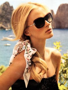 Poppy sunglasses from Louis Vuitton 2011 collection.  Love this look with the scarf in the hair.  So chic.