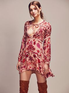 Saffron Mini | Gorgeous silk super mini dress featuring a bohemian floral print and crochet accents. Sultry plunging neckline with adjustable ties and soft bell sleeves with button closures. Flirty, flowy silhouette. Lined.