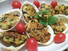 Wild Rice Crab Cakes 1 cup cooked wild rice 2 cups crab meat I cup salad shrimp 2 tablespoons (each) onion and celery sauté in butter (cool) add ingredients together an form into small cakes. Fry in grape seed oil until golden brown on each side.