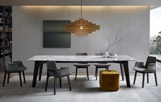 Howard Jean-Marie Massaud (2011) A simple, refined and timeless style has driven the essential design of this table. A self standing structure in refined wood and steel with a smoked velvet-like grey plate framed by a small setting in wood in order to provide refinement and warmth.