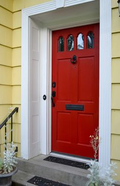 Amazing Red Front Door In White Frame For Old Fashioned Facade With Concrete Stairs
