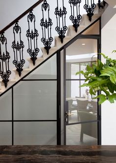 Iron work, staircase and doors. Tour a Stunningly Chic London Townhouse via Wrought Iron Staircase, Staircase Railings, Stairways, Railing Design, Staircase Design, Gio Ponti, Crittall, London Townhouse, Victorian Buildings