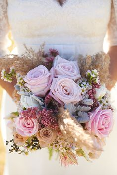 Dusky pink, rustic bouquet of roses, parrot tulips, wax and more, including an absolute favourite – pepper berry. (photo by Nikole Ramsay)