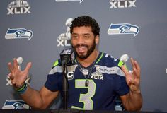 Seattle Seahawks QB Russell Wilson Gets Slammed By Fans on Twitter After Tweeting He Likes 50 Shades of Grey | FatManWriting