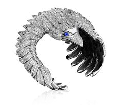 The Eagle Soul Cuff in 18k white gold with diamonds and sapphires.  #tabbah #houseoftabbah