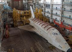 Abandoned Russinan Shuttle Program: The images reveal how the shuttles and the hangar have been left to rot over the years, with dust piling up on the ground and wings