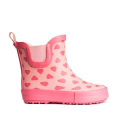 Patterned rain boots with elastic panels at sides. Fluted soles.