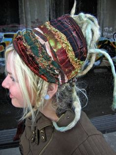 I think this is intergalactic apparel on etsy, but I love the headband and want to make one for myself.