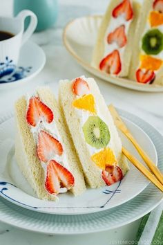 Brighten your day with Japanese Fruit Sandwich called Fruit Sando! Juicy seasonal fresh fruits are embedded in chilled whipped cream between two slices of pillowy Japanese milk bread. These colorful sandwiches with strawberries, orange, and kiwi are perfect for breakfast and snack! #fruitsandwich #strawberry #sandwich #shokupan | Easy Japanese Recipes at JustOneCookbook.com Japanese Sandwich, Japanese Milk Bread, Japanese Food, Japanese Desserts, Snack Recipes, Dessert Recipes, Juice Recipes, Sushi Recipes, Gourmet Desserts