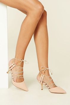 A pair of faux suede pumps featuring a strappy design, elasticized lace-up top, pointed toe, and an open back. This is an independent brand and not a Forever 21 branded item.