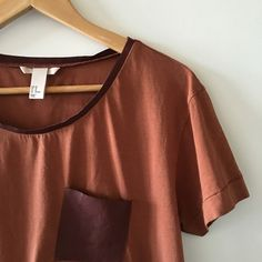 | H&M | 100% Leather Pocket Brown T-Shirts Gently worn 100% cotton and details are 100% leather. Also 100% leather trim on collar. Little wrinkle-like stretch on the bottom of the pocket. But otherwise great condition!! Comfortable and chic basic design for summer season I would style it as oversized tuck-in style with skinny pants   ⇸ m y  c l o s e t ⇷ ✓ i accept all reasonable offers  ✓ make me an offer ♥ × no trade × no paypal H&M Tops Tees - Short Sleeve