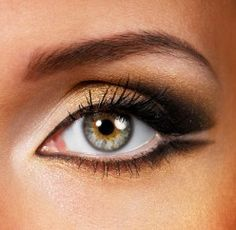 lighter color shadow inside corner shimmery gold center lid & below bottom lashes brown outlining eye, crease blend and leave outer corner light colored, which opens up the eye and distinguishes top from bottom lashes