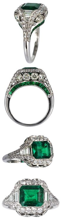 Elegant 2.26ct Colombian Emerald & Diamond Ring. Platinum custom made Colombian Emerald and diamond filagree ring with millgrain edges. Consisting of one bezel set emerald cut Emerald weighing approximately 2.26 carats and calibre cut emeralds along the undergallery. The emeralds are accented with full cut round and baguette diamonds having an approximate total weight of 1.75 carats. #VintageJewelry #ArtDecoJewelry