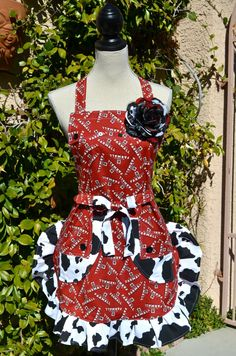 Cow Print Farmall McCormick Print Apron Listing by OliviabyDesign, $28.95  I want this! Except for the stupid flower!