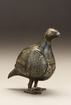 Bird-shaped vessel century Saljuq period Brass inlaid with copper, glass bead; case, incised and chased Probably Iran Islamic World, Islamic Art, Ceramic Animals, Ceramic Birds, World Birds, Ancient Persian, Ancient Near East, Persian Culture, Iranian Art
