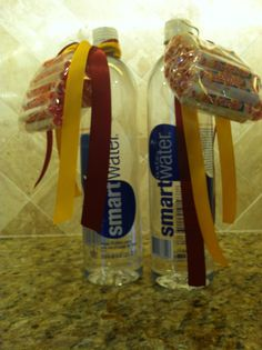 Going to college gift.  Smart water and Smarties tied with school color ribbons.  Great way to start college...smart!! High School Graduation Gifts, 8th Grade Graduation, Graduation Party Favors, Graduation Open Houses, Graduation 2016, College Gifts, School Gifts, Grad Parties, Graduation Ideas