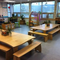 a Reggio inspired classroom. Check out how homework supplies are on the table with plants, gives it a home like cozy feeling