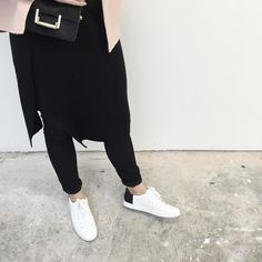 """""""Yesterday's layering techniques; the ribbed wrap skirt over my fave CKs and new sneaks. Warm is the new chic ya know."""""""