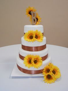 SUNFLOWER WEDDING CAKE except purple ribbons