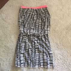 adorable comfy dress Very comfortable and flattering. Elastic waistline. Fully lined. Only worn a few times. Making room in my closet. Measures approximately 14.5 inches on top unstretched and 15 inches waistline unstretched. If you have any questions feel free to ask. Sweet Pea Dresses Mini