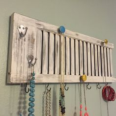 Shutter jewelry rack, shutter decor, Jewelry holder, jewelry display, shutter with knobs, jewelry organizer, jewelry storage, shabby chic by PeavyPieces on Etsy https://www.etsy.com/listing/239424634/shutter-jewelry-rack-shutter-decor