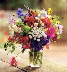 Mason jars filled with wild flowers make great centerpieces