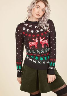 Sugarplum Scary Sweater   Mod Retro Vintage Sweaters   ModCloth.com  Prove that 'macabre' is the new 'merry' by celebrating in this black sweater! Intarsia snowflakes and pine trees mix and mingle with skulls, skeleton snowmen, and the most 'brainless' reindeer of all, making up the white, red, and green designs that deem this pullover a gift to flaunt.