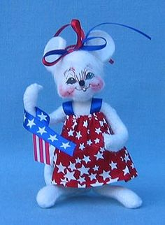 """Annalee 4"""" Patriotic Girl Mouse  Annalee Doll Description: Open eyes, closed mouth with or without tooth, white body and hair with blue and red bow, red with white star print dress, holds patriotic ribbon. Companions are 203606 and 203604."""