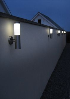Looking for an easy way to enhance an outdoor setting? The Canterbury Solar Wall Light does this and more with an elegant glow emitted from the white diffuser and simple installation in under 10 minutes. Outdoor Wall Lighting, Outdoor Walls, Solar Wall Lights, Canterbury, House Yard, Solar Led, Lighting Online, Detached House, Door Handles